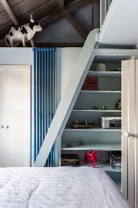 cool bedroom shelves in London Ensor Mews luxury apartment