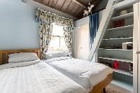 nice bedside furnishings in South Kensington London Ensor Mews luxury apartment