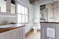 fresh and clean toilet and bath in London Ensor Mews luxury apartment