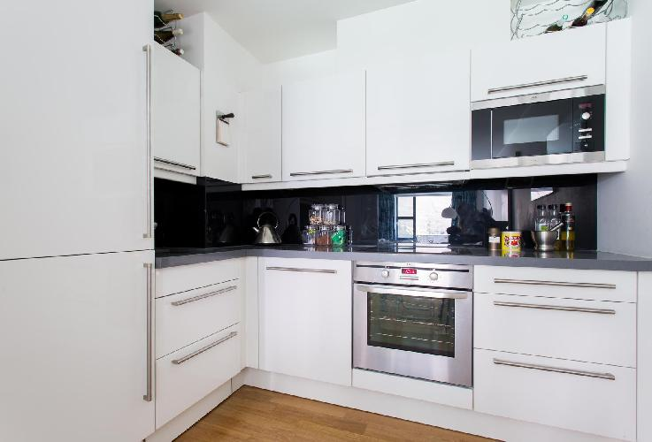 whitewashed modern kitchen of London Blandford Street II luxury apartment