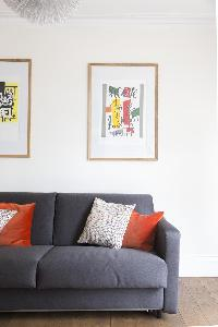 plush sofa and nice framed art in London Colville Road III luxury apartment