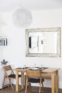 pretty mirror and ceiling lamp in the dining area of London Colville Road III luxury apartment