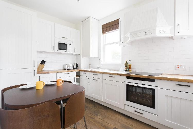 fine kitchen details and modern appliances in London Colville Road III luxury apartment