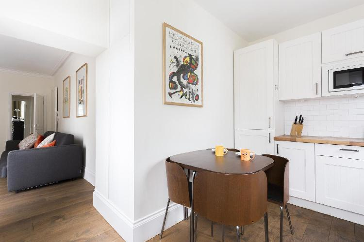 cool art by the dinette in London Colville Road III luxury apartment