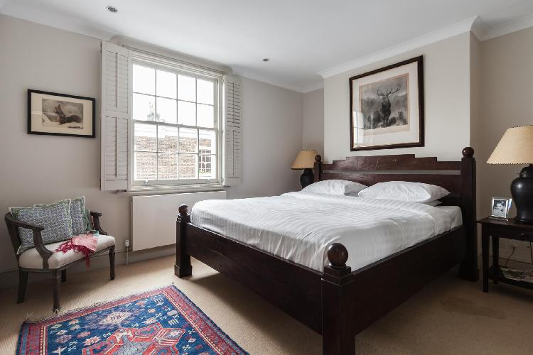 spacious and serene bedroom of London Campden Street V luxury apartment