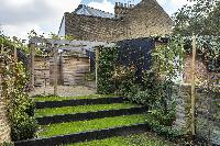 multi-tier, grass-carpeted outdoor sanctuary in London Albion Road luxury apartment