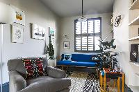 sunny and airy sitting room of London Albion Road luxury apartment