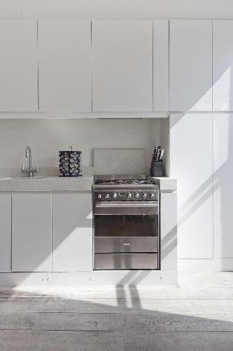 state-of-the-art kitchen appliances in London Bassett Road IV luxury apartment