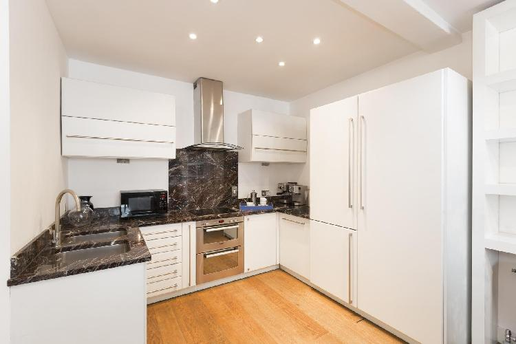 granite-trimmed kitchen of London Berners Street luxury apartment
