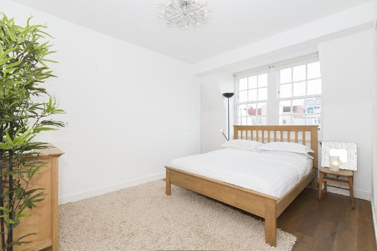 sunny and airy bedroom of London Berners Street luxury apartment