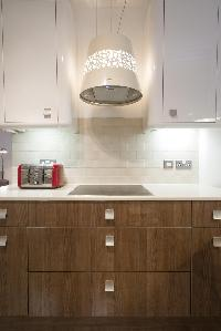 pendant lamp above kitchen counter in London Addison Bridge Place luxury apartment