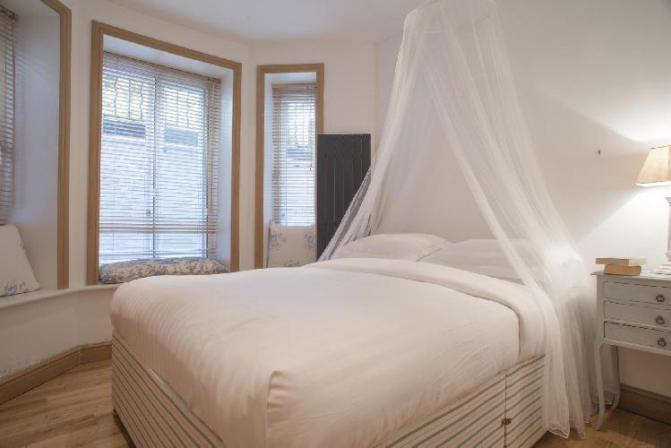peaches-and-cream bedroom in London Addison Bridge Place luxury apartment