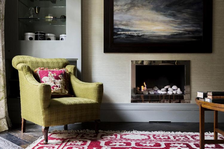 comfy chair by the fireplace of London Belgravia Place luxury apartment and holiday home