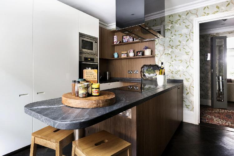 modern kitchen with peninsula in London Belgravia Place luxury apartment