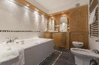elegant bathroom with tub in London Alwyne Place luxury apartment