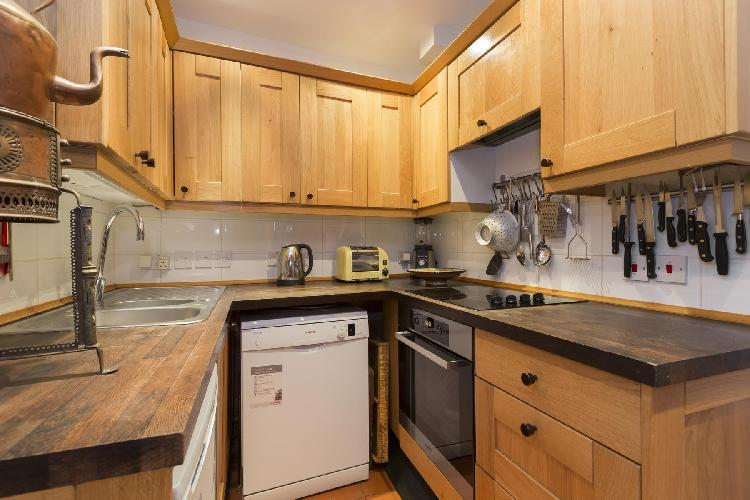 cool modern appliances and cabinets in the kitchen of London Godfrey Street II luxury apartment