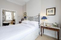 fresh and clean bed linens in London Winchendon Road luxury apartment