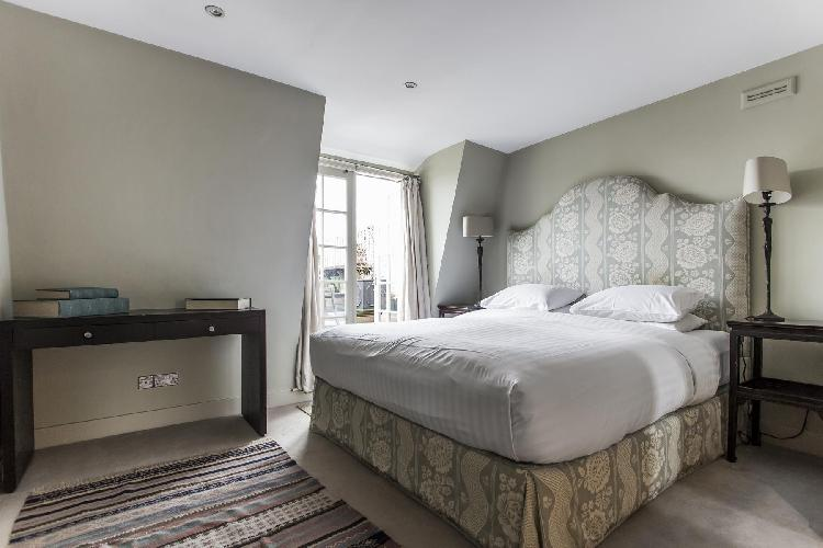 well-appointed bedroom in London Cornwall Gardens III luxury apartment