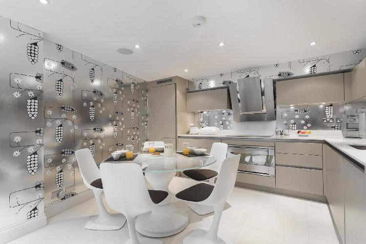 fascinating dining area and kitchen of London St Catherine's Mews luxury apartment
