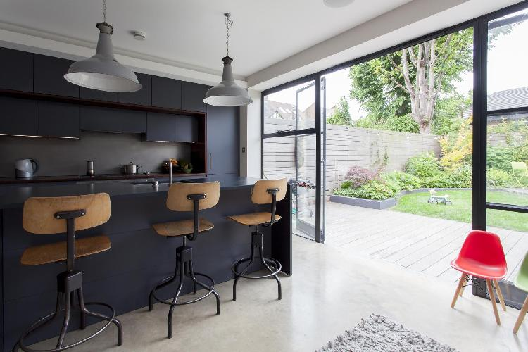 wide glass doors leading to the well-maintained garden of London Ardilaun Road luxury apartment