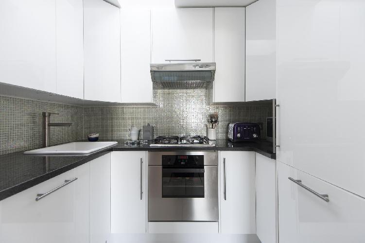 sleek kitchen with modern appliances in London Cranley Place III luxury apartment
