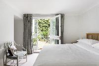 well-appointed bedroom in London Beaufort Gardens luxury apartment