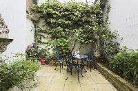 cool patio with garden chairs in London Beaufort Gardens luxury apartment