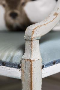 detail of a fine-crafted chair in London Beaufort Gardens luxury apartment