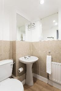 neat toilet in London Beaufort Gardens luxury apartment