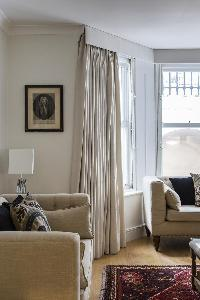 comfy couches in London Beaufort Gardens luxury apartment