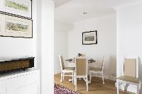 charming round-table dining at London Beaufort Gardens luxury apartment