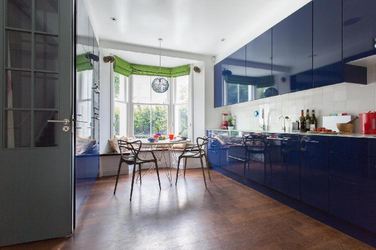 spacious blue-splashed kitchen with generous bay window in London Coningham Road II luxury apartment