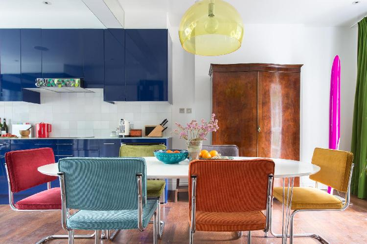 bright-colored dining chairs and fixtures in London Coningham Road II luxury apartment