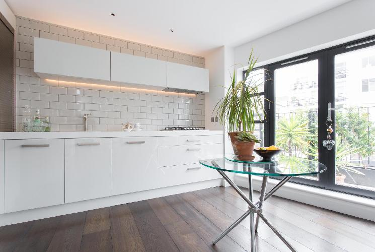 cool kitchen access to the balcony of London Hatton Place luxury apartment