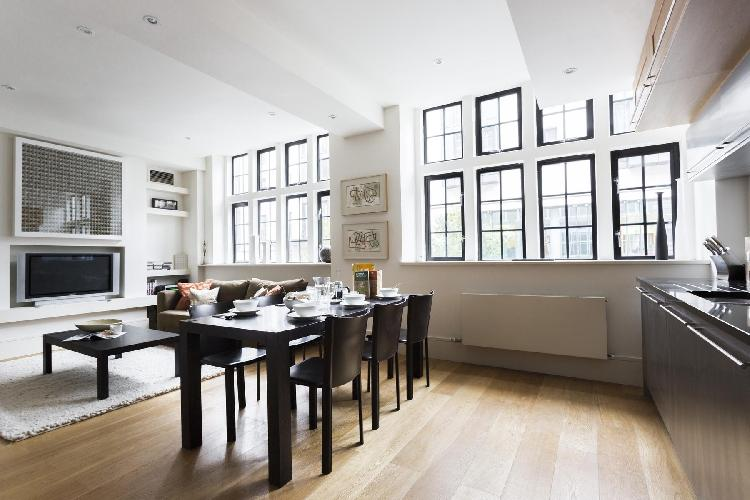 awesome windows drawing sunshine into the living room of London Great Portland Street luxury apartme