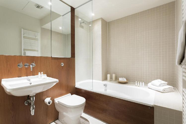 fresh and trim bathroom with tub in London Great Portland Street luxury apartment