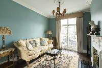 pretty living room and balcony of London St Mary's Gardens II luxury apartment