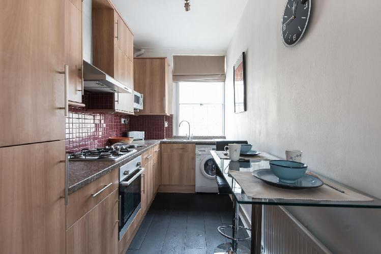 nice compact kitchen with modern appliances in London Coram's Fields luxury apartment