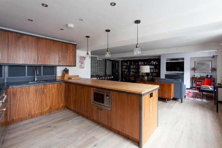 nice wood-trimmed kitchen with late-model appliances in London Calvin Street luxury apartment