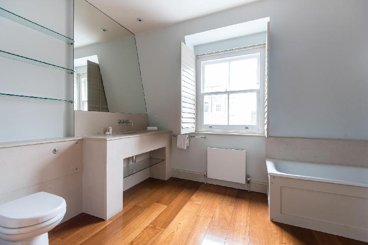cool bathroom with tub in London Gregory Place luxury apartment