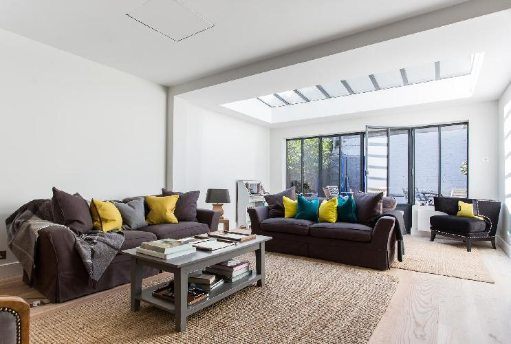 sitting room with skylight and glass doors in London Altenburg Gardens IV luxury apartment