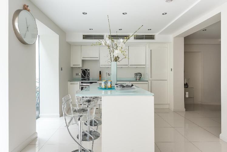 impeccable whitewashed kitchen in London Cheyne Row II luxury apartment