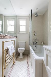 pristine bathroom interiors with an energizing red trim in London Albert Bridge Road II luxury apart