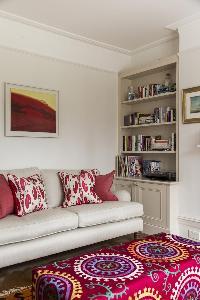 plush sofa by the vibrant carpet in the sitting area of London Albert Bridge Road II luxury apartmen