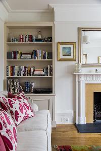 bookshelf next to the fireplace in London Albert Bridge Road II luxury apartment