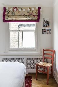 bedroom chair by the window in London Albert Bridge Road II luxury apartment