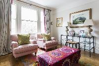 quaint seating by the generous window in the parlor of London Albert Bridge Road II luxury apartment
