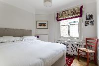 large bed in London Albert Bridge Road II luxury apartment