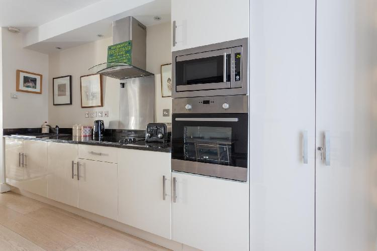 fine-crafted kitchen cabinets and modern appliances in London Bramerton Street V luxury apartment