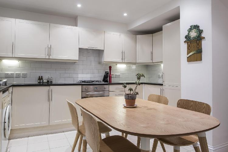 cool dining area and kitchen of London St Matthew's Row luxury apartment